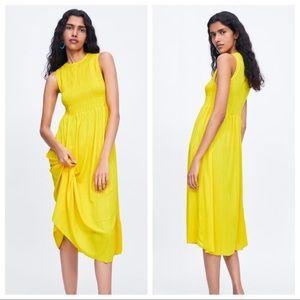 NWT. Zara Yellow Smocked Dress. Size S.